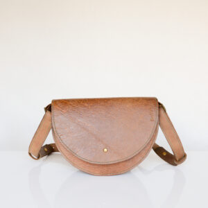 Handmade tan shoulder bag made from reclaimed and upcycled leather. Made with green contrast stitching and with adjustable shoulder strap.