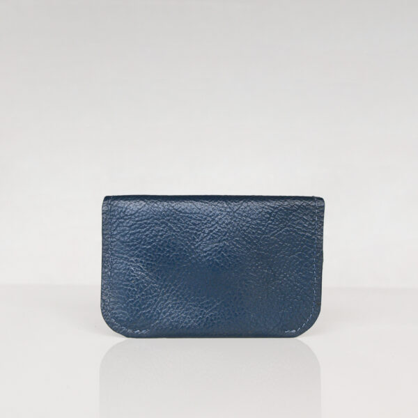 Back view of dark blue minimalist card wallet made from reclaimed and upcycled leather