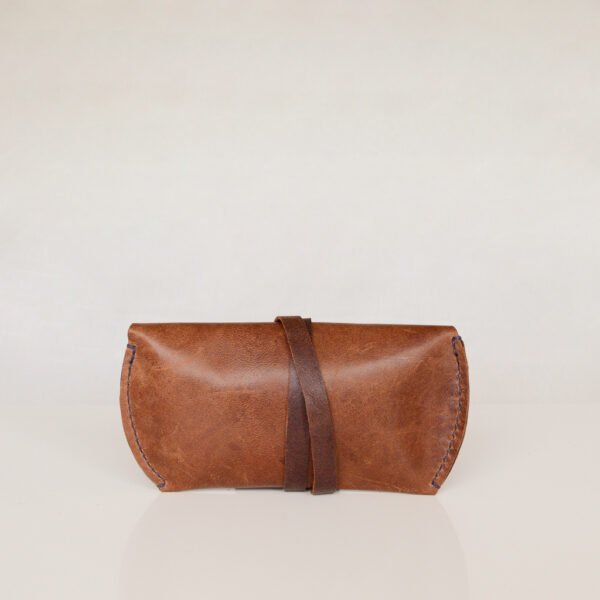Rear view of brown leather glasses case made from reclaimed leather.