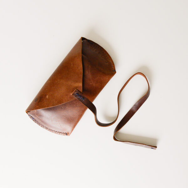 Brown leather glasses/sunglasses case with leather cord closure. Made from reclaimed and upcycled leather
