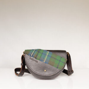 Unique dark brown shoulder bag made from upcycled leather with green tartan across flap and on strap
