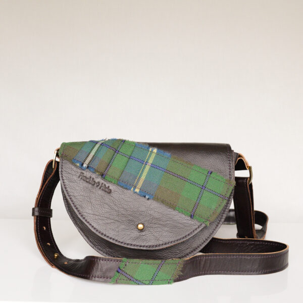 Handmade dark brown shoulder bag made from reclaimed and upcycled leather with green tartan across flap and on the adjustable strap
