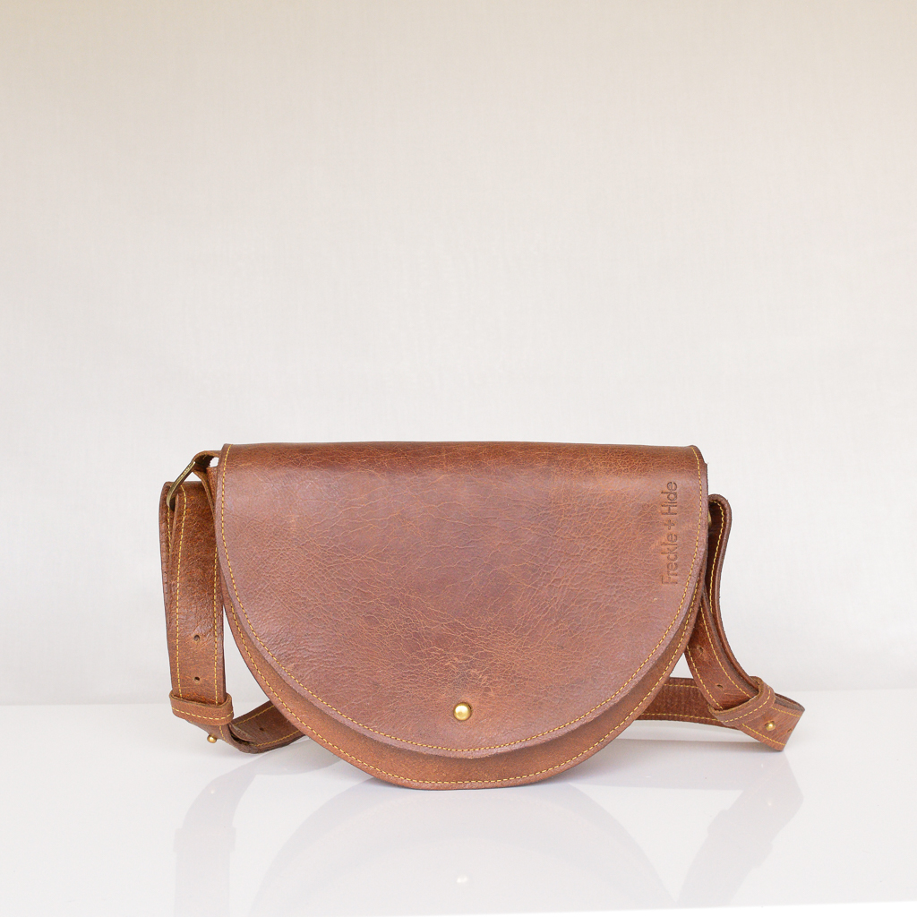 Luxury tan leather shoulder bag with yellow stitching and adjustable strap