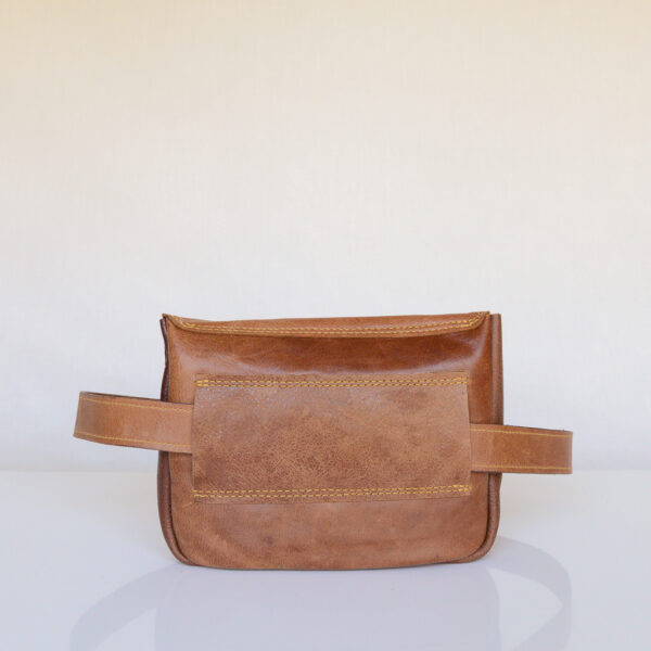 Rear view of rectangular tan leather waist bag made from reclaimed and upcycled leather