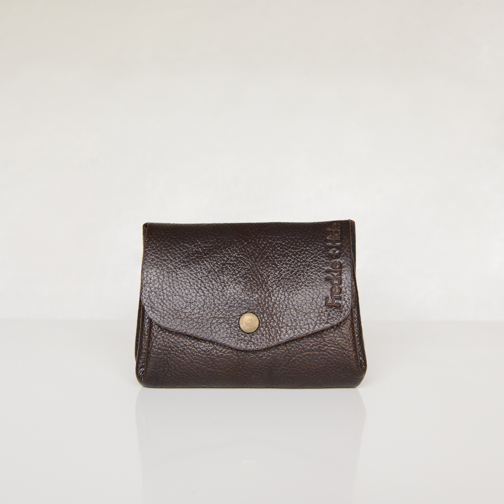 Dark brown leather wallet with antique brass popper on curved front flap