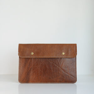 Recycled leather laptop sleeve in brown with blue contrast stitching