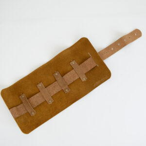 Tan cable tidy made from reclaimed and recycled leather