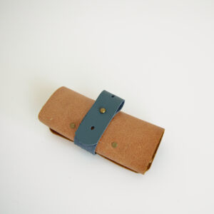 Tan and blue cable tidy made from reclaimed and recycled leather